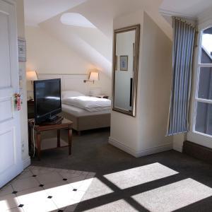 Ein Bett oder Betten in einem Zimmer der Unterkunft Hotel Scherf