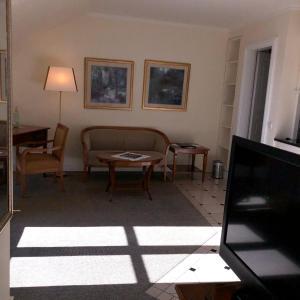 Ein Sitzbereich in der Unterkunft Hotel Scherf
