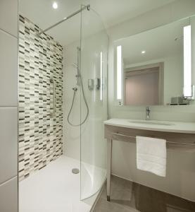 A bathroom at Hampton By Hilton Leeds City Centre