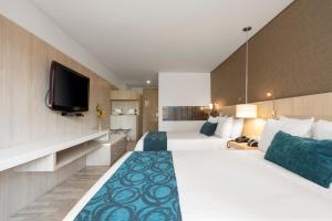Cama o camas de una habitación en Hotel bh Bicentenario