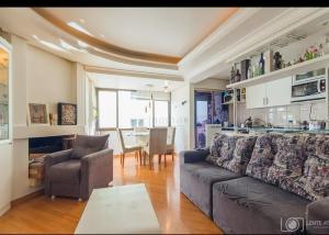 A seating area at Apartamento Aconchegante em excelente localização