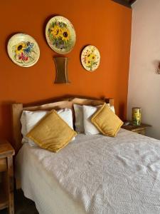 A bed or beds in a room at Pousada Fecho da Serra