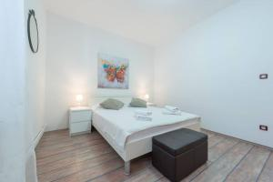 A bed or beds in a room at Villa Mlini with private Pool and Sea view