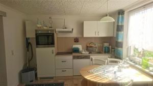 Küche/Küchenzeile in der Unterkunft Ferienwohnung Neuensien