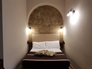 Letto o letti in una camera di Hotel Il Convento