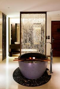 A bathroom at Hansar Samui Resort & Spa - SHA Plus
