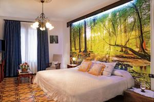Cama o camas de una habitación en Casa Rural Bodega de los Lobera