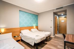 A bed or beds in a room at Scheppers Hotel&Hostel