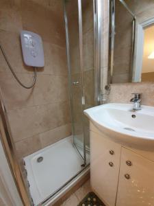 Um banheiro em Belgravia Rooms Hotel
