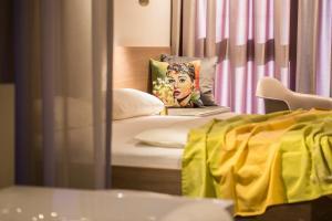 Кровать или кровати в номере hirschen dornbirn - das boutiquestyle hotel