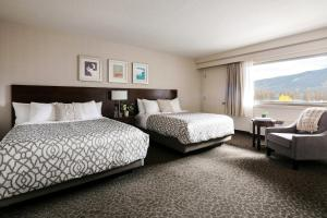 A bed or beds in a room at The Crimson Jasper