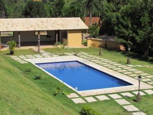A piscina localizada em Hotel Fazenda Topada ou nos arredores