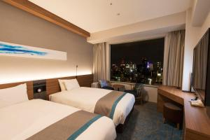 A bed or beds in a room at Sapporo Prince Hotel