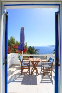 A balcony or terrace at Filoxenia by Grispos Villas
