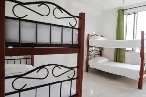 A bunk bed or bunk beds in a room at Deportel Cali