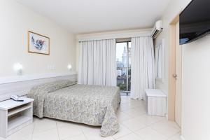 A bed or beds in a room at Hotel Suárez Executive Novo Hamburgo