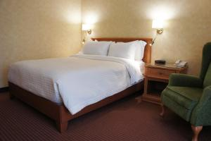 Кровать или кровати в номере Hôtel Castel