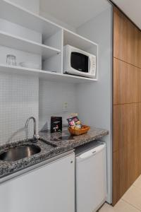 A kitchen or kitchenette at Citi Hotel Residence Caruaru