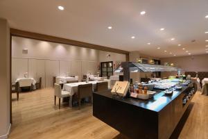 Restaurant ou autre lieu de restauration dans l'établissement Guitart Grand Passage