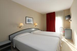 Кровать или кровати в номере Hotel Guitart Central Park