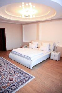 A bed or beds in a room at Altair Hotel