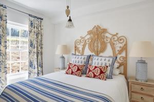 A bed or beds in a room at La Cotte Forest Cottages