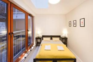 A bed or beds in a room at WaterLane Island Hostel&Apartments