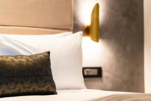 A bed or beds in a room at SKYE Suites Sydney