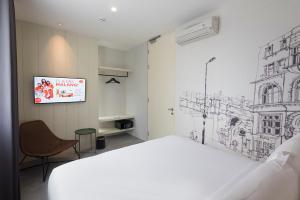 Кровать или кровати в номере HARRIS Hotel & Conventions Malang