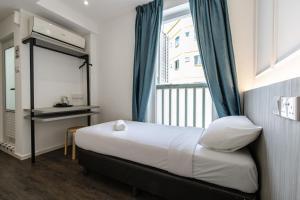 Ein Bett oder Betten in einem Zimmer der Unterkunft Marrison Desker @ Little India (SG Clean)