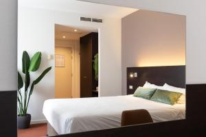 A bed or beds in a room at Ariane Hotel