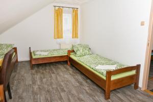 Postel nebo postele na pokoji v ubytování Penzion pod svahem