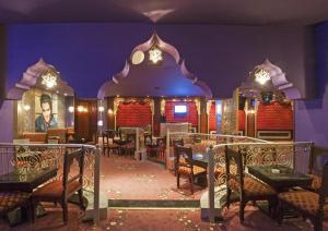Een restaurant of ander eetgelegenheid bij Sentido Mamlouk Palace Resort