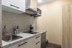 A kitchen or kitchenette at RentWill Borovskoe 4-4