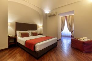 A bed or beds in a room at Decumani Hotel De Charme