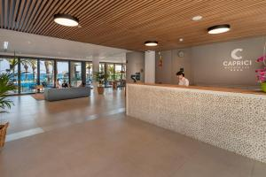 The lobby or reception area at Caprici Beach Hotel & Spa