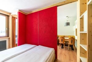 A bed or beds in a room at Ambiez Residencehotel