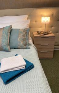Posteľ alebo postele v izbe v ubytovaní Penzión Aira