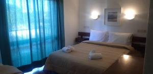 A bed or beds in a room at Residencial Campo-Mar - by Portugalferias