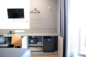 Et tv og/eller underholdning på Hotel Alif Campo Pequeno