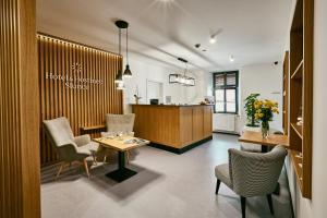 Vstupní hala nebo recepce v ubytování Hotel a Hostinec Slunce