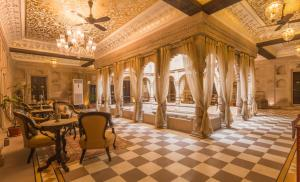A restaurant or other place to eat at BrijRama Palace- A Heritage Hotel