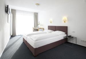 Ein Bett oder Betten in einem Zimmer der Unterkunft Hotel Klingelhöffer