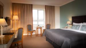 A bed or beds in a room at Celtic Ross Hotel & Leisure Centre