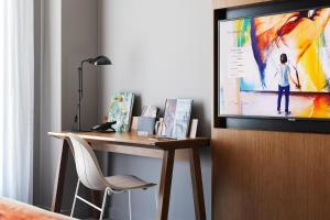 A television and/or entertainment center at Art Series - The Adnate