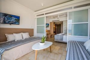 A bed or beds in a room at Kiani Beach Resort Family All Inclusive