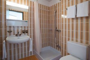 A bathroom at Parkhotel Brenscino Brissago