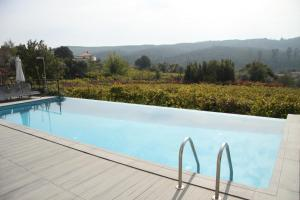 The swimming pool at or near Casa Valxisto