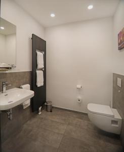 Ein Badezimmer in der Unterkunft CityPension-Vreden