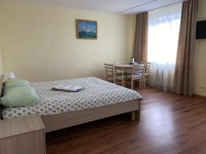 A bed or beds in a room at Hotel & Hostel Kruiz